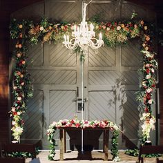 Flowers really do make a venue special - we also love the chandelier touch for added elegance.  #RusticWedding