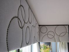 White linen cornices with silver nailhead trim