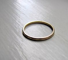 Classic solid gold hammered stacking ring from tinahdee on etsy.  My dream wedding band.