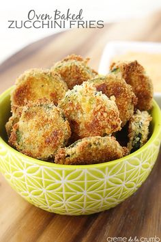 Crispy oven-baked zucchini fries with a spicy dipping sauce! A lightened up appetizer or side dish that will be on the table in less than 30 minutes!