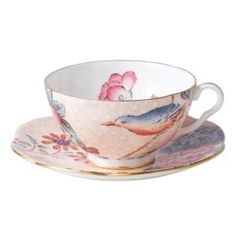 Step into a delightful garden party with Wedgwood's whimsical Cuckoo collection. Inspired by nature, this richly accented tea cup and saucer adds a flourish of color to your table with sophisticated a