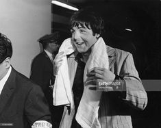 Paul McCartney of The Beatles dries off with a towel while returning to the hotel after the band's 3rd concert at Budokan, Tokyo, Japan, July 1, 1966.