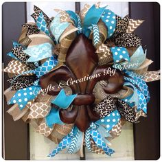 Fleur de Lis animal print wreath. More wreaths can be found on my Facebook page: www.facebook.com/CraftsandCreationsByTerri or go to my Etsy page https://www.etsy.com/shop/CreatedByTerri