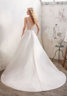 Morilee by Madeline Gardner 'Maribella' 8123 | Understated and Elegant, This Stunning Marcella Satin A-Line Bridal Gown Features a Crystal Beaded Sheer Back and Waistline. Covered Buttons Trim the Back and Train.