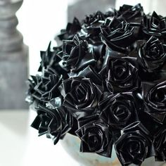 black roses perfect for the dining room table or coffee table in a spooky vase with an orange ribbon.