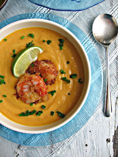 carrot soup topped with coconut shrimp