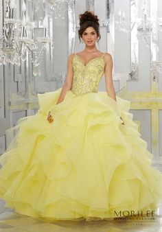 Yellow Gold Perfect for a Grand Entrance, This Stunning Organza Quinceañera Ball gown Combines an Exquisitely Beaded V Neck Bodice with a Dreamy Flounced Skirt. Matching Stole Included. Colors Available: Blush, Lemonade, Lilac, White. Princess Beauty and the Beast Ball Gown Sweet 15 Dress by Vizcaya | Morilee by Madeline Gardner. Style 89148.