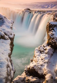 At the Godafoss waterfall in Iceland.