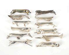 12 porte-couteaux animaux Art Déco, Gallia Christo , 12 ART DECO KNIFE RESTS BY CHRISTOFLE, CIRCA 1930