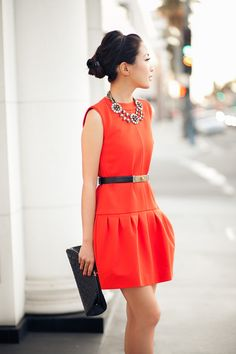 Orange Drop-waist silhouette and statement necklace, black clutch #fashion