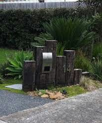 Oh my, I could love this in the front garden with railway sleepers and a cool letterbox. Please, honey, please!