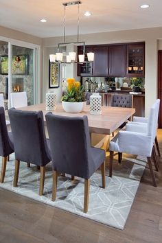 Contemporary dining room features a rope sphere chandelier hanging ...