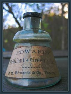 EDWARDS' Brilliant Green Ink is a cone ink bottle that is Canadian made by C.M.Edwards & Co., Toronto