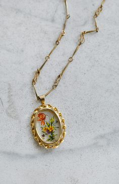 vintage 1980s long necklace with floral pendant