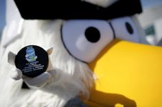 The mascot HockeyBird poses with the official puck of the 2012 IIHF Ice Hockey World Championships in Helsinki, Finland on May 8, 2012.