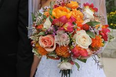 Bride's bouquet. Dahlias, roses, ranuculus, freesias, wax, misty