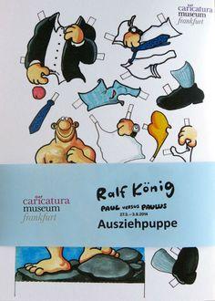 """Ralf Königs Ausziehpuppe! Das exklusive und nur im caricatura-Shop erhältliche Schmankerl zur Ausstellung """"Ralf König - Paul versus Paulus"""""""
