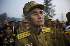 North Korean veterans of the Korean War enter a cemetery for Korean War veterans on Thursday, July 25, 2013 in Pyongyang, North Korea during an opening ceremony marking the 60th anniversary of the signing of the armistice that ended hostilities on the Korean peninsula. (AP Photo/David Guttenfelder)