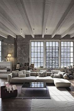 Big windows + clean lines + simple color palette. Beautiful modern apartment space. Open space