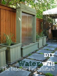 DIY PATIO WATER WALL How we turned salvaged panes of tempered glass into a water wall feature for our outdoor living space.  http://www.interiorfrugalista.com/2014/08/diy-patio-water-wall.html