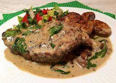 Koteletter i senneps-flødesovs med champignon og spinat