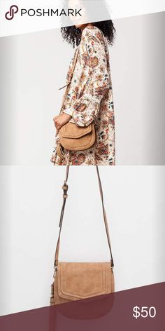 "Free People Jackie Crossbody Bag From Free People Line Violet Ray Jackki saddle crossbody bag. This faux leather suede bag features a magnetic button flap with a zip close main compartment and an inner zip. Outer open slit pocket. Removable tassel bag charm and adjustable prong shoulder strap. Allover tonal stitch detailing. 7.5 x 8 x 2.25"". Imported. Free People Bags Crossbody Bags"