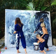 Have your kids paint a picture to be the focus piece of your living room