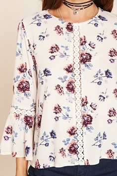 A woven floral print top featuring a front crochet accent, crochet cutouts on the trumpet sleeves, and a self-tie keyhole back. Kurta Designs, Blouse Designs, Hijab Fashion, Fashion Dresses, Couture Tops, Indian Designer Wear, Work Attire, Blouse Styles, Dress Collection