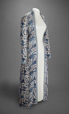 Early 1700's Indigo dyed chintz women's dressing gown (wentke) Constructed in Hindeloopen, Imported to The Netherlands, mid-18th century. Cotton, resist-dyed and painted; gown, lined with linen, trimmed with Dutch weft-patterned tape (langetband). Veldman-Eecen Collection