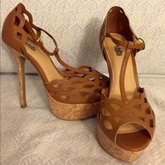 Heels Brown heels with middle strap up the middle of the foot.  Cork looking bottom.  Worn once. Shoes Heels