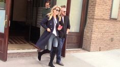 Beaming Christie Brinkley and rocker boyfriend John Mellencamp step out in New York City. The happy couple both wore jeans and a white top. Christie went with a blue coat while John went with a black one.