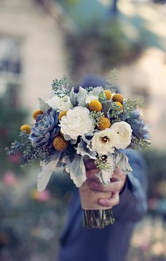 Unusual choice of flowers clustered together, but it works if the bride really, really loves blue!!