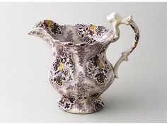 An 1840s chintz ware 'Sheet patterned' jug. 7.25in (18.5cm) ...
