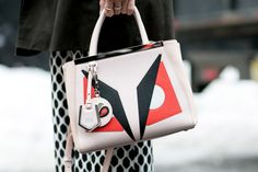 ace9d73af457 We adore this fierce Fendi clutch. - Street Style Accessories  NYFW Fendi  Clutch,