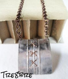 Corsetto - necklace in foldformed aluminium foil, with handmade chain