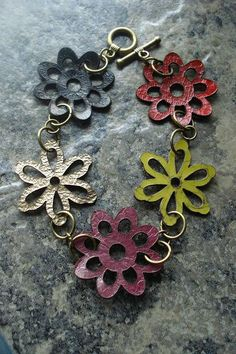 LOVE this! Leather Flower Bracelet Laser cut Leather Flowers by AJBcreations