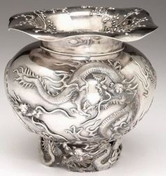 "silver & gold, China, Chinese export silver vase, Wang Hing & Co., Hong Kong, circa 1900.  ""The undulating rim with cherry blossoms, the ovoid body decorated with a continuous band of dragons, raised on a pierced circular foot further decorated with dragons."""