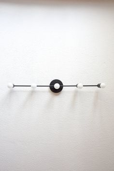 Stunning matte black 5 bulb wall sconce. This fixture is constructed of solid brass and steel coated in a commercial grade baked on finish called powder coating. Suitable for bathroom use. Handmade in the U.S.A. with top quality components. Can be installed in the vertical or horizontal position Can also be installed on the ceiling. Max 300 watts (60w per socket). UL LISTED Model 138. 110/220V compatible. Base is 5 wide, fixture is 29.25 or 33.25 in width, 5 in total depth, 1 from the wall…