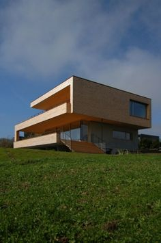 The Alberschwende house's architectural makeup consists of sleek lines and natural materials that zigzag into an organic Z shape. K M Architecture designed it along the outskirts of Alberschwende, Austria where it overlooks the hilly mountains to the south.