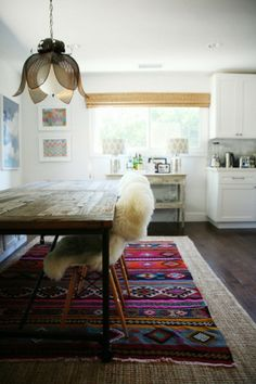 layered rugs- interesting idea. Also love this light fixture.