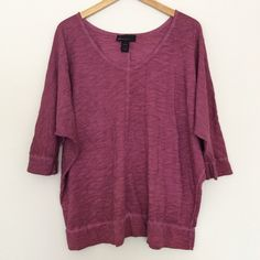"""Lane Bryant Plum Dolman Top 18/20 Casual, 100% cotton knit dolman top in washed space-dyed plum with a drapey fit. In very good used condition with no holes, stains, or tears.  Marked size 18/20  MEASUREMENTS LAID FLAT: Bust: free up to approx. 33.5"""" Length: 28"""" Width at hem band: 24.5"""" Arm opening: 5""""  Reasonable offers considered. Thanks for looking! Lane Bryant Tops"""