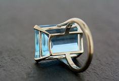 +++WE WILL BE ON HOLIDAY FROM 23RD TO 31ST MARCH. ORDERS WILL BE SENT OUT ON THE 1ST APRIL+++A simply fabulous Art Deco ring with a large, rectangular, deep-blue aquamarine that sits proud from the finger. A classic style of cocktail ring popular from the 1920s onwards. This is made