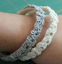 Yo Yo bracelet DIY. I would skip the bangle part and just glue them to felt with a small attachment.
