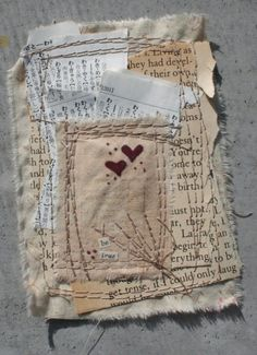 I altered fabric and papers combined with decorative stitching on the surface to create this small textural piece of art. The small hearts drawn onto the