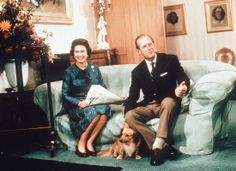 1974 ... Queen Elizabeth II & Prince Phillip with one of their puppies at Balmoral Castle, Scotland