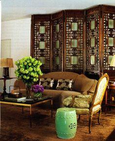 decorative screen behind sofa