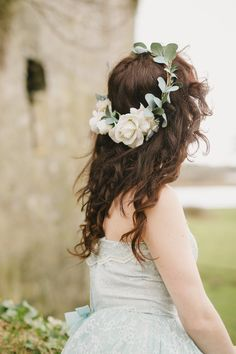 "Sienna is created with light cream and ivory roses which look and feel so  realistic. Sage eucalyptus leaves are intertwined throughout her design for  a romantic aesthetic. She's perfect for the ethereal bride to grace her  locks as she says her vows.  This floral crown measures ~22"" in c"