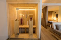 Sentiotec vitamy - upgrade you hotel suite with premium infrared cabins Hotel Suites, Cabins, Divider, Room, Furniture, Home Decor, Products, Bedroom, Decoration Home