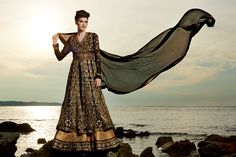 A rich, black and gold ensemble in a floor length 'Anarkali' style. Heavy 'zari' and 'pita' work all over. Combined with a black chiffon dupatta.