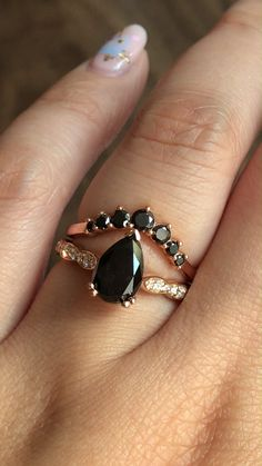 Verlobungsring videos Pear Black Diamond from our Grace Solitaire collection with scalloped diamond band paired gracefully with our curved 7 stone black diamond wedding ring! See more from our black diamond collection! Black Diamond Wedding Rings, Unique Diamond Engagement Rings, Rose Gold Engagement Ring, Vintage Engagement Rings, Unique Rings, Goth Wedding Ring, Wedding Jewelry, Ring Set, Ring Verlobung